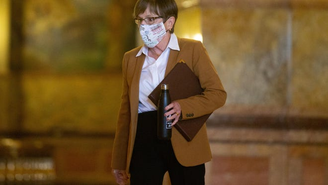 Gov. Laura Kelly's executive order requiring masks to be worn in all public spaces will take effect at 12:01 a.m. Friday.