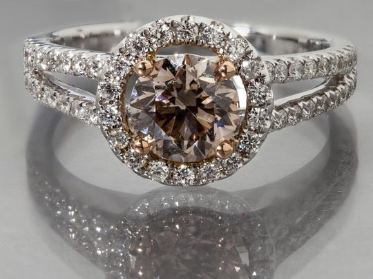 Custom-designed Champagne diamond in an 18K white gold diamond halo setting. From Michael & Son's Jewelry Company.