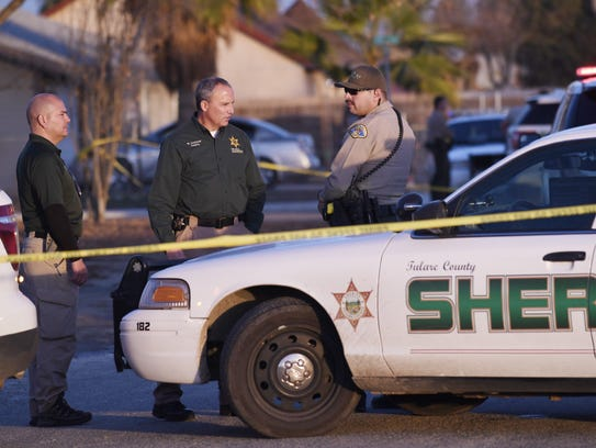 Tulare County sheriff's deputies investigate a shooting at Camp Drive and Wills Avenue in Goshen on Wednesday, Dec. 10, 2018.