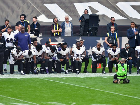 Sep 24, 2017; London, Middlesex, ENG;  Thirteen Baltimore Ravens players kneel as the US National Anthem is played before the game between the Jacksonville Jaguars and the Baltimore Ravensat Wembley Stadium. Mandatory Credit: Steve Flynn-USA TODAY Sports
