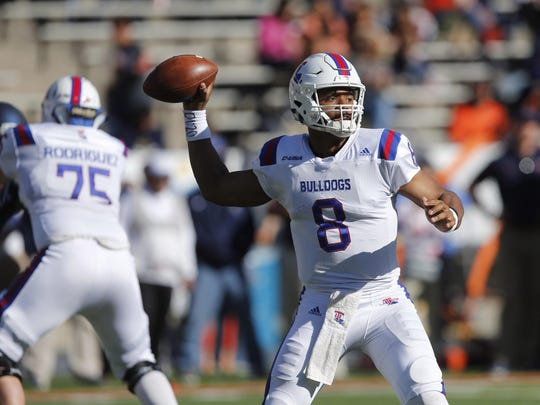 Louisiana Tech quarterback J'Mar Smith (8) drops back to pass the ball against the UTEP Miners defense at the Sun Bowl.