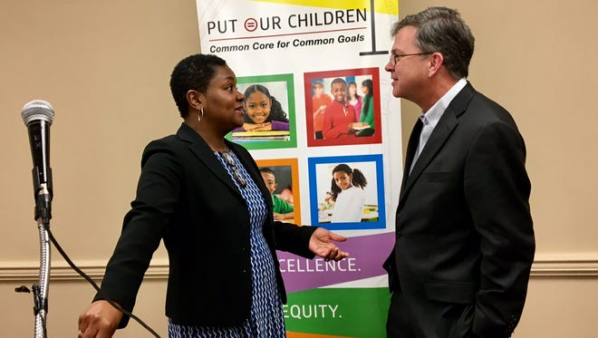 Louisville Urban League President Sadiqa Reynolds, left, talks to AT&T Kentucky President Hood Harris at an announcement event about low-cost Internet service.
