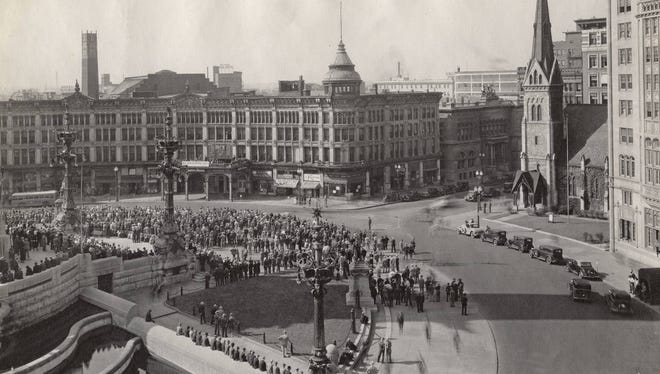 Crowds formed around the northeast quadrant in front of the English Theatre and Hotel to view the electric scoreboard for World Series updates in 1934.