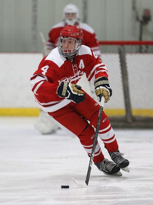 Penfield's Jack Schlifke controls the puck near center ice during a game last season.