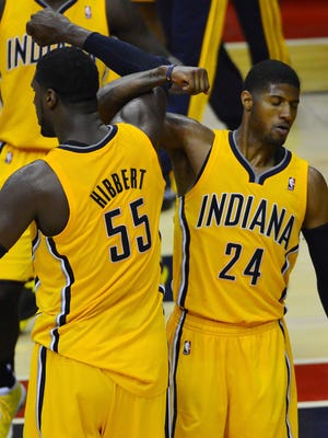 Pacers center Roy Hibbert, left, and forward Paul George led a dramatic comeback in the third quarter Sunday in Game 4 vs. the Wizards.