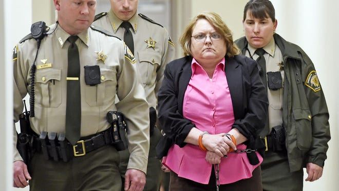 Found guilty of Capital Murder, Joyce Hardin Garrard is led back to the Etowah County Detention Center in Gadsden.