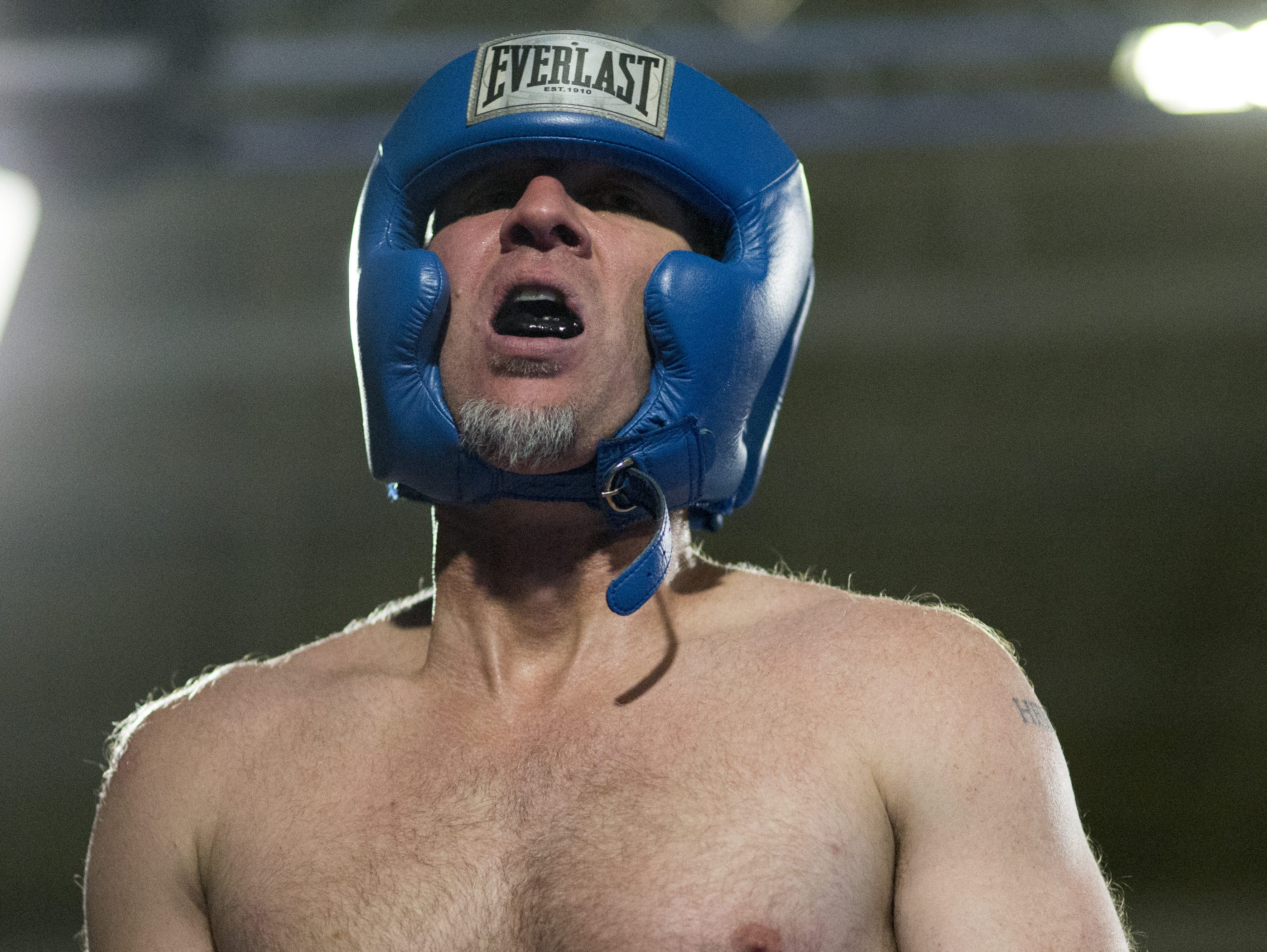IndyStar columnist Gregg Doyel on Aug. 7, 2015, caught his breath in between rounds as he boxed former UFC fighter Chris Lytle during a charity event for Rock Steady Boxing, Indianapolis.