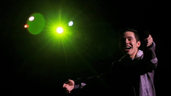 David Archuleta points his microphone at the crowd