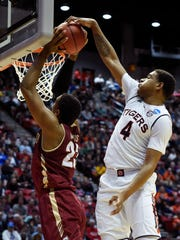 Auburn forward Chuma Okeke (4) blocks a shot and fouls
