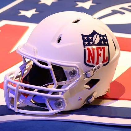 File Photo: A helmet and NFL shield logo