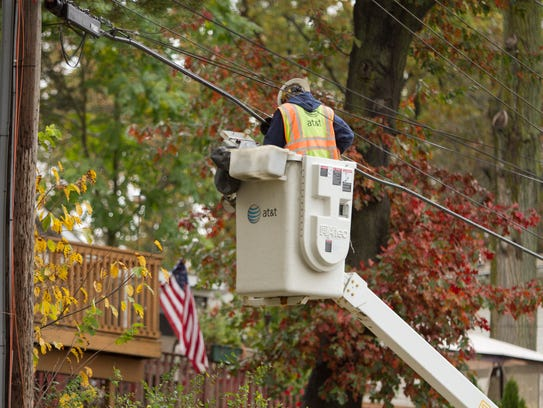 A worker works on utility lines Tuesday, Oct. 24, 2017