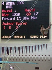 Milford's Jack Aman captured the 1-meter diving event