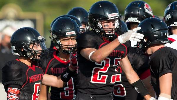 Lourdes Academy players exits the field for a Knight's timeout playing Friday on J.J. Keller Field at Titan Stadium September 1, 2017.