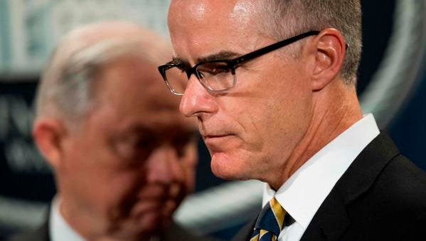 In this file photo taken on July 13, 2017, Acting Director of the FBI Andrew McCabe, right, and US Attorney General Jeff Sessions attend a press conference at the US Department of Justice in Washington, DC. Andrew McCabe was fired late March 16, 2018 by Sessions.