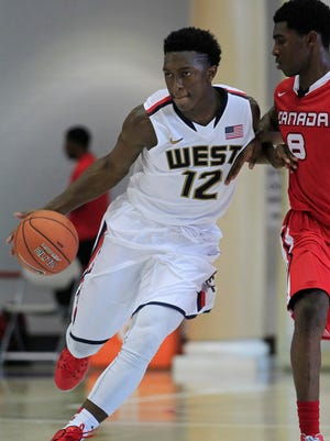 Team USA West player Stanley Johnson (12) dribbles the ball against Team Canada during the Nike Global Challenge at Trinity University.