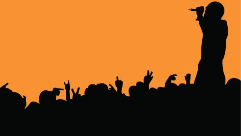 Crowd silhouette at music concert with artist singing with orange background