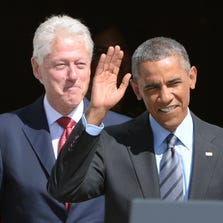 Former president Bill Clinton and President Obama walk out of the White House to speak at an event marking the 20th anniversary of AmeriCorps.