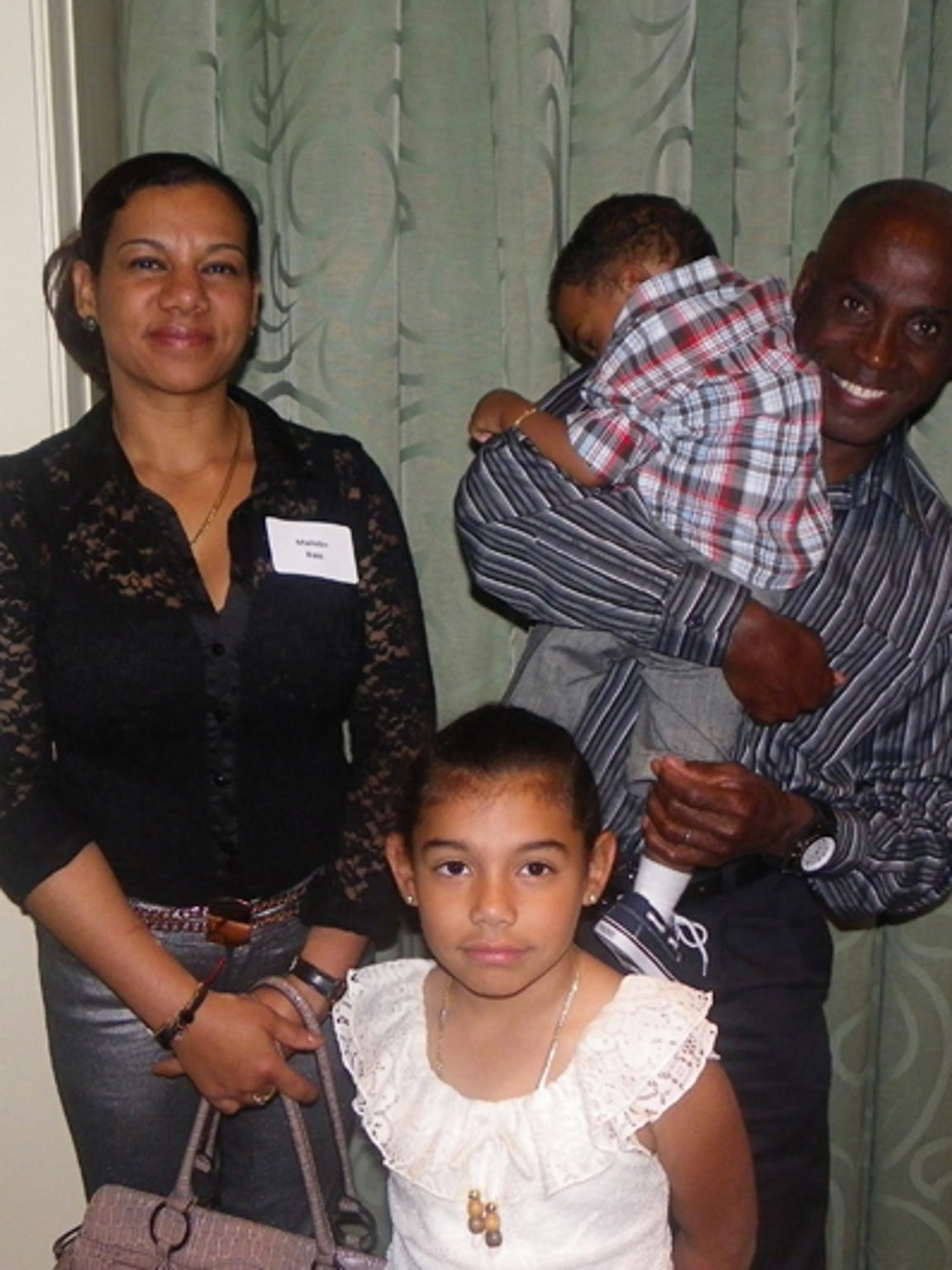 James Bain is pictured with his wife and children.
