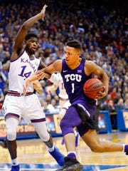 Desmond Bane of TCU (1) drives to the basket.
