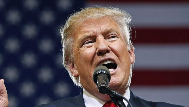 Republican presidential candidate Donald Trump speaks at a rally Saturday in Phoenix.