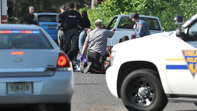 Vineland police and EMS respond to a person laying in the road in the 1400 block of North West Avenue on Sunday in Vineland.