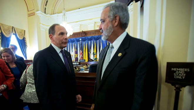 Veterans Affairs Secretary Bob McDonald, left, talks to House Veterans Affairs Committee Chairman Rep. Jeff Miller, R-Fla., on Capitol Hill in Washington Oct. 7 at the conclusion of the committee's hearing on the Veterans Health Administration.