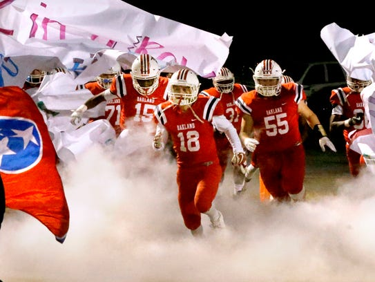 The Oakland football team takes the field before the