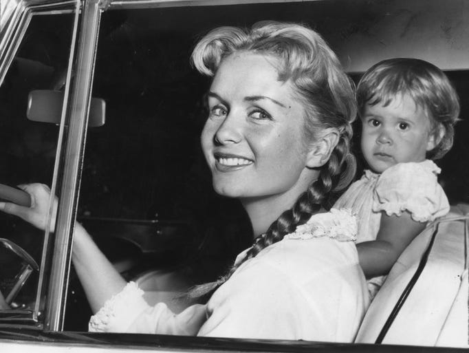 Debbie Reynolds, with daughter Carrie, 23 months old,