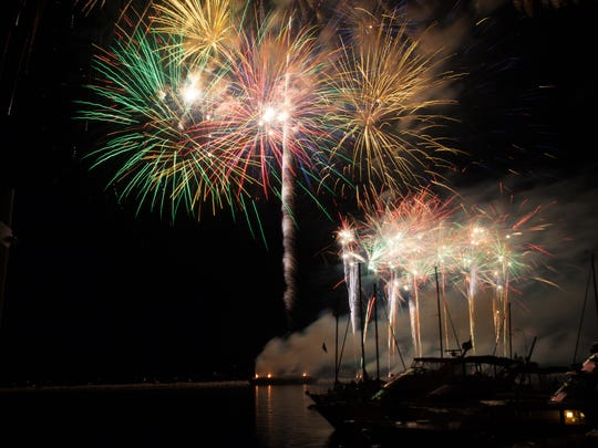 Fireworks light up the water above Lake Champlain during the annual July 4th celebration in Burlington on Sunday, July 3, 2016.