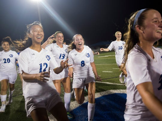 The Barron Collier girl's soccer team celebrates after defeating Naples High School 2-0 in the Class 3A-District 14 Championship game at Barron Collier High School Friday, Jan. 20, 2017 in Naples.