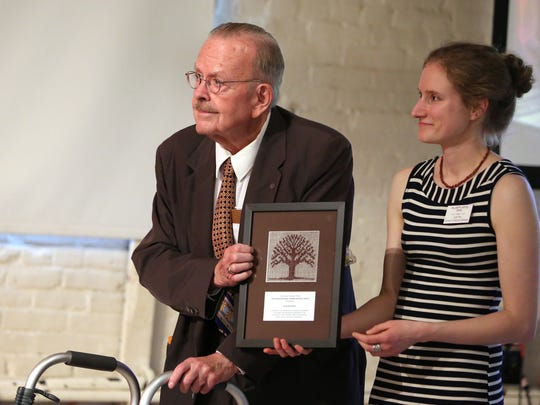 Curator Kylie Pine presents Scott McArthur with the David Duniway Lifetime Historian Award at the 24th Annual Heritage Awards at Willamette Heritage Center on Friday. McArthur spend the last 60 years preserving local history in his teaching, writing and research.