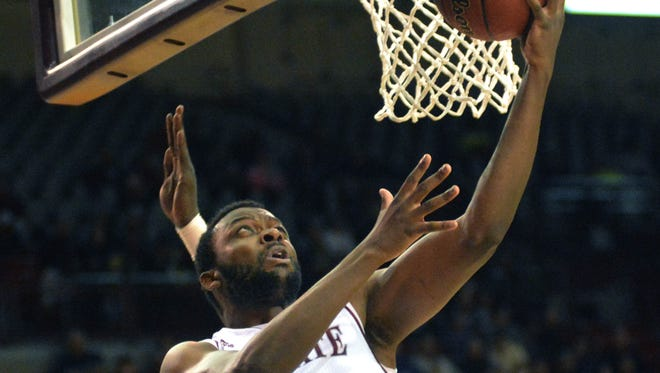 New Mexico State's Johnathon Wilkins goes in for a reverse layup against Oral Roberts Monday night at the Pan American Center.