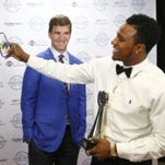 Amir Tyler poses with Eli Manning (Tom Costello photo)