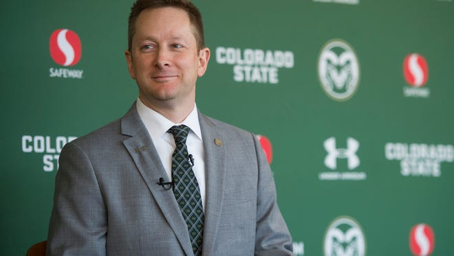 CSU men's basketball coach Niko Medved waits to be introduced during a press conference announcing his new position with the Rams on Friday, March 23, 2018.