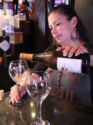 Bartender Rachael Conrad pours wine at the popular,