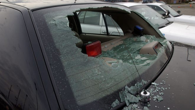 A closer view of a shattered rear window of an unmarked Detroit police car sits in the parking lot of the Detroit Police Department's 9th Precinct in Detroit, Saturday, Jan. 1, 2005. The windows of several police cars were shot out during New Year's Eve celebration. There were no injuries. WILLIAM ARCHIE/Detroit Free Press
