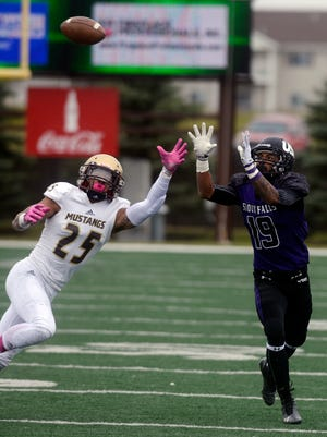 USF's Solomon St. Pierre intercepts a pass intended for Southwest Minnesota State's Nathaniel Huot  before carrying it in for a touchdown in Saturday's game at Bob Young Field, Oct 18, 2014.