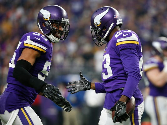 Minnesota Vikings cornerback Terence Newman, right, celebrates with teammate Anthony Barr after intercepting a pass during the second half of an NFL football game against the Cincinnati Bengals, Sunday, Dec. 17, 2017, in Minneapolis. (AP Photo/Bruce Kluckhohn)