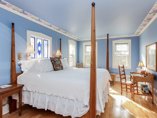 The calm blue walls in the Avery Beach Hotel Suite are sure to relax you during your vacation.