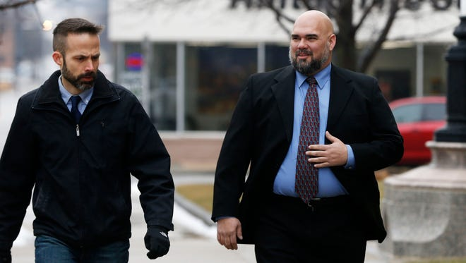 Former state Sen. Kent Sorenson, right, arrives for his sentencing hearing at the federal courthouse in Des Moines.