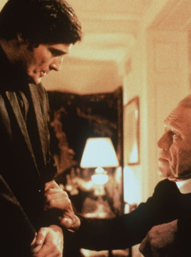 """Father Karras (Jason Miller, left) and Father Merrin (Max von Sydow) battle evil in """"The Exorcist"""" (1973)."""