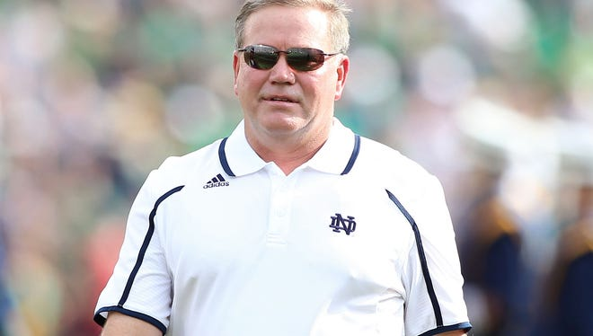 Notre Dame Fighting Irish coach Brian Kelly coaching on the sidelines against the Temple Owls at Notre Dame Stadium. Kelly addressed the media Saturday regarding the academic investigation of four players.