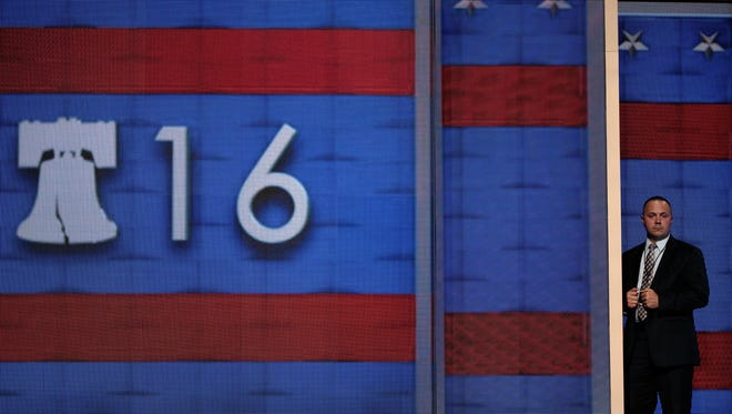 A security agent stands on the stage ahead of the Democratic National Convention at the Wells Fargo Center, July 24, 2016 in Philadelphia, Pennsylvania.