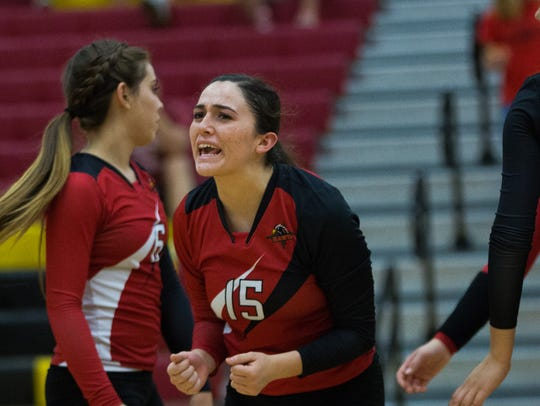 Centennial setter Raquel Gonzales (15) is one the top