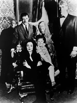 Ken Weatherwax (seated right), played Pugsley on The Addams Family television series in the 1960s,