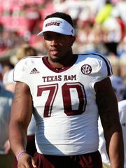 Cedric Ogbuehi looks on during his final season with the Texas A&M Aggies. Ogbuehi spent one season with Von Miller there.