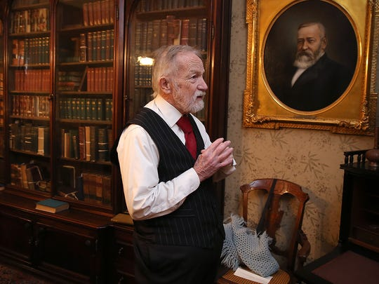 President Benjamin Harrison, played by Ed Myers, waits for visitors in his office at the President Benjamin Harrison Home.