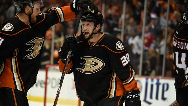 Anaheim Ducks left wing Matt Beleskey is congratulated for scoring the game-winning goal against the Chicago Blackhawks during the overtime period in Game 5 of the Western Conference final.