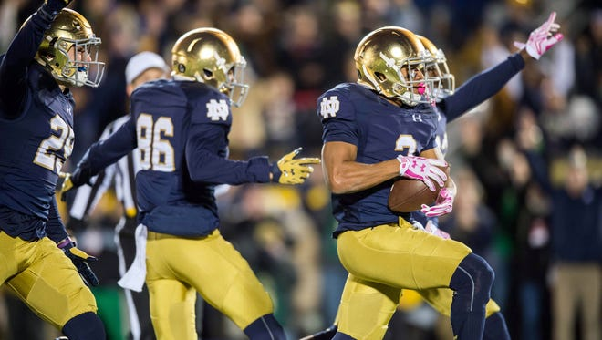 Oct. 17, 2015; South Bend, Ind.; Notre Dame Fighting Irish wide receiver Amir Carlisle (3) scores a touchdown after a fumble recovery in the first quarter against the USC Trojans at Notre Dame Stadium.