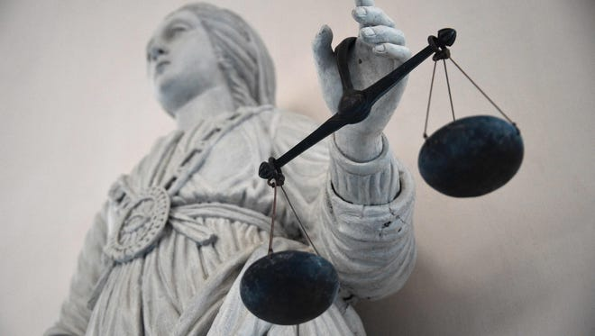 This file photo shows a picture taken on May 19, 2015 of a statue of the goddess of justice balancing the scales in Rennes' courthouse, France.